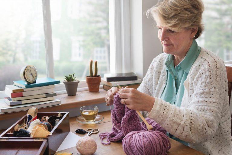 Senior woman knitting hobby at home