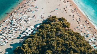 Overhead shot of very busy beach with ocean on each side