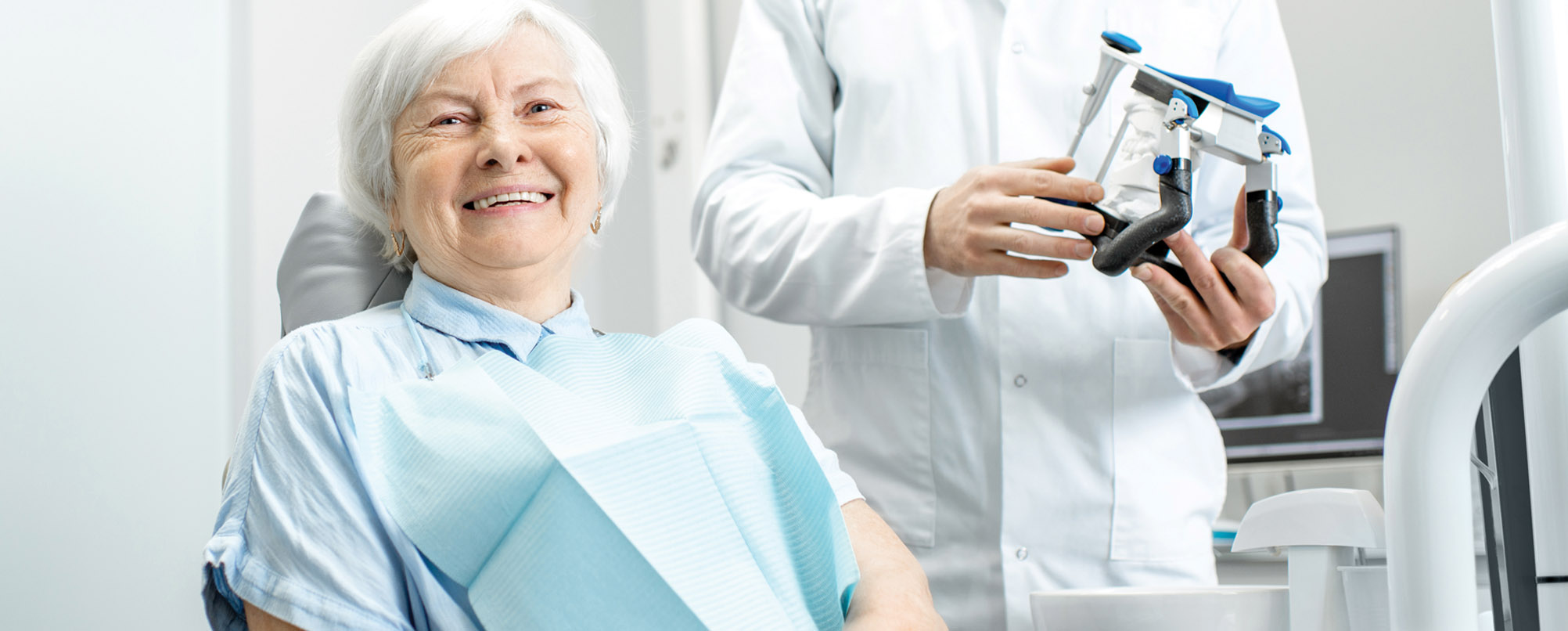Happy senior woman at dentist
