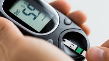 Glucose meter measuring blood sugar level for diabetes