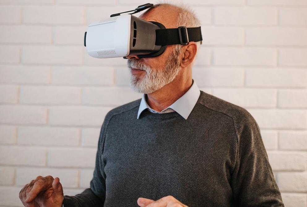 Senior man wearing VR headset