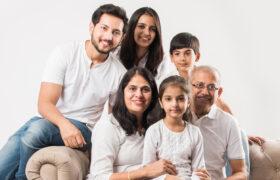 Senior couple poses with children and grandchildren