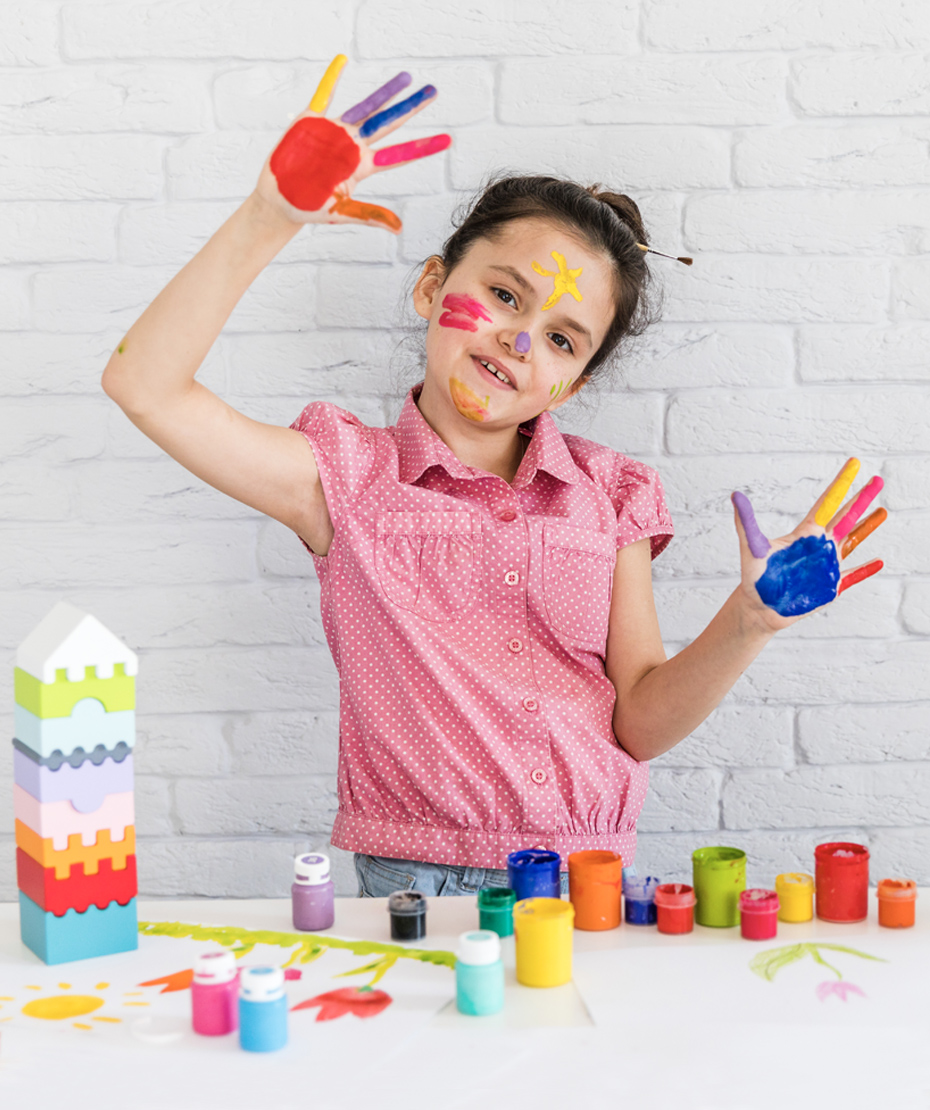 Granddaughter plays with finger-paints and blocks