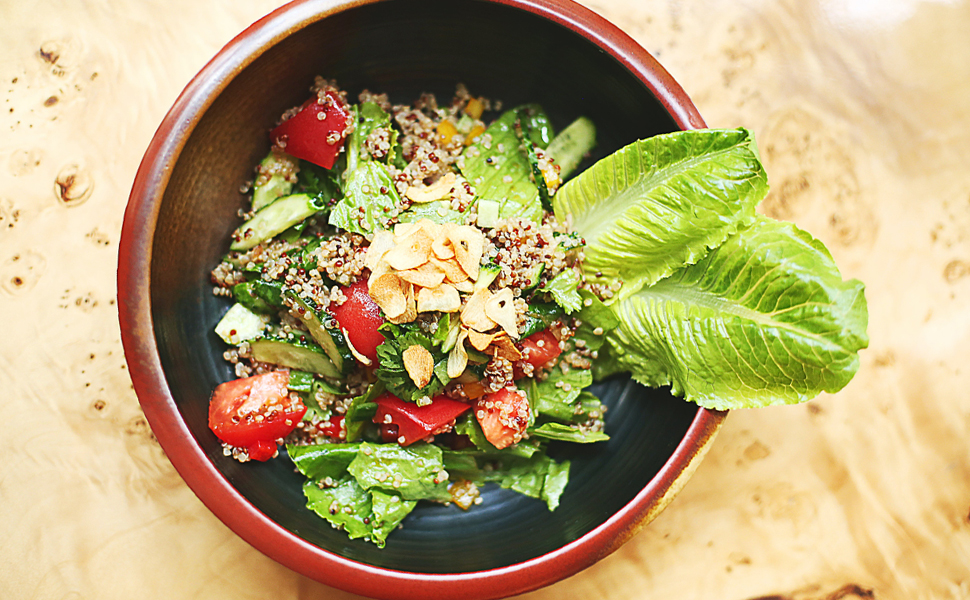 Health meal of nuts, greens, and tomatoes