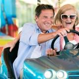 Senior couple enjoying bumper car ride