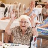 Senior woman wins bingo in care retirement home