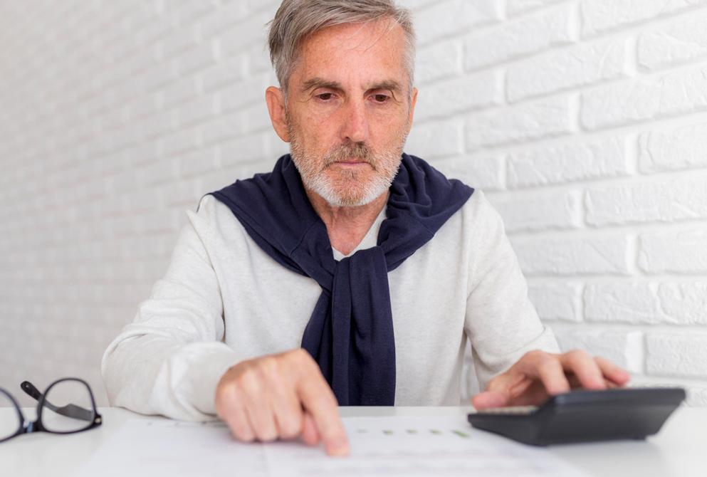 Senior man calculates finances
