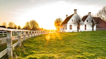 Retirement cottage near farm at sunrise