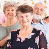 Several happy seniors pose for photo