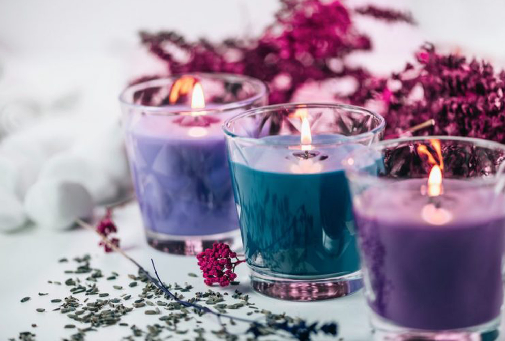 Light purple and blue scented candles with lavender around