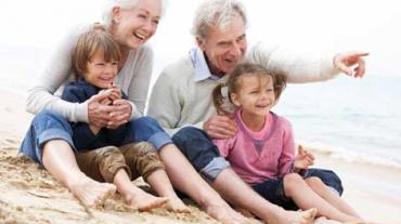 Seniors With their Grandchildren on the beach