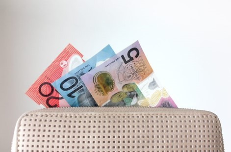 Australian Money sticking out of a purse