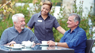 Seniors enjoying coffee in their care home