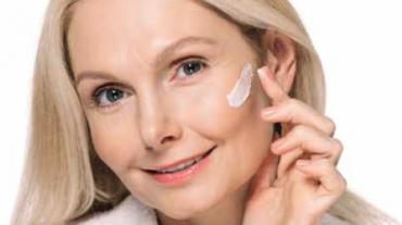 Senior applying face cream