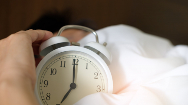 Clock wrapped in white sheets