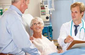 Doctors Caring For Senior in Hospital Bed