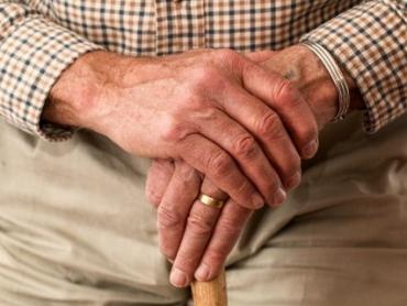 senior holding a walking stick