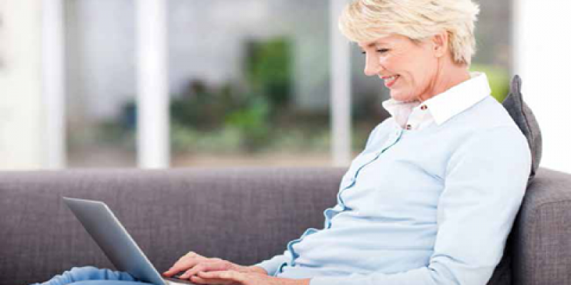 Lady typing on a laptop