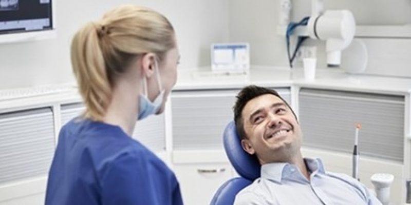 Smiling at a dentist