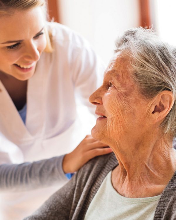 Senior woman assisted by carer