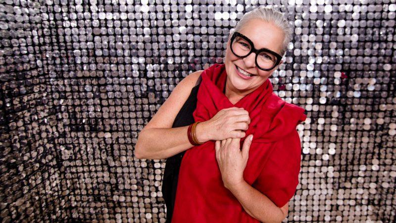 happy-woman-in-silver-shiny-room - Copy