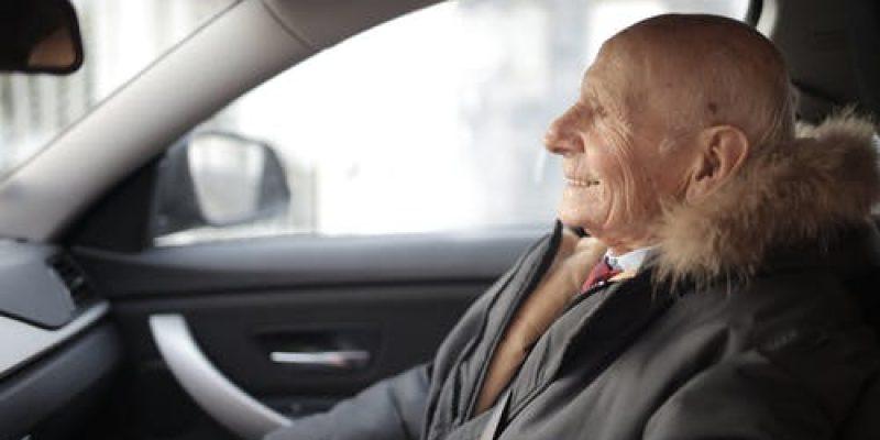 Senior sitting in a passenger seat